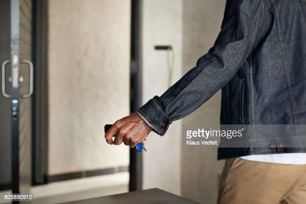 Senior man grabbing keys, when leaving apartment
