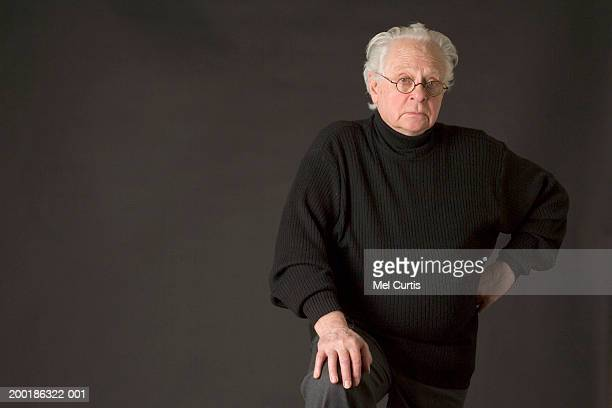 Senior man, hand on hip, portrait