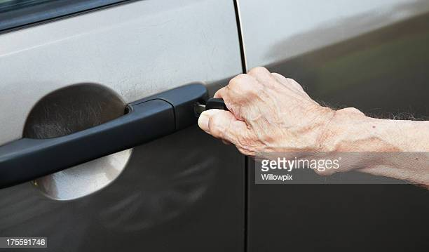 Senior Man Hand Unlocking Car Door