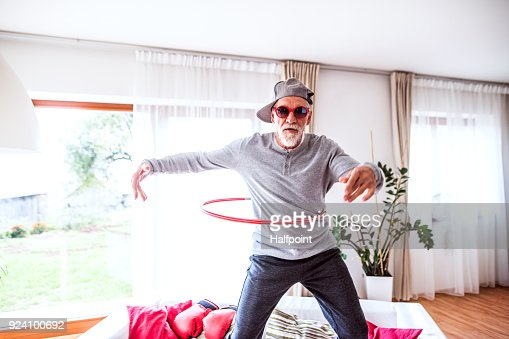 Senior man having fun at home. : Foto de stock