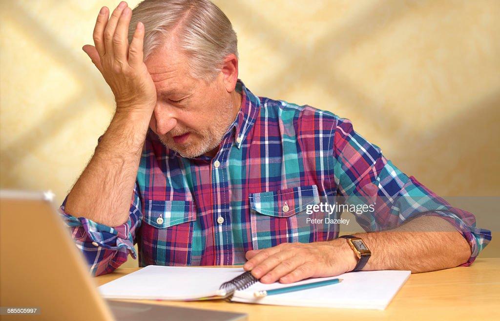 Senior man having memory loss
