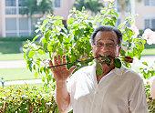 Senior man holding a flower in his teeth