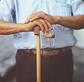 Senior man holding a traditional greek stick