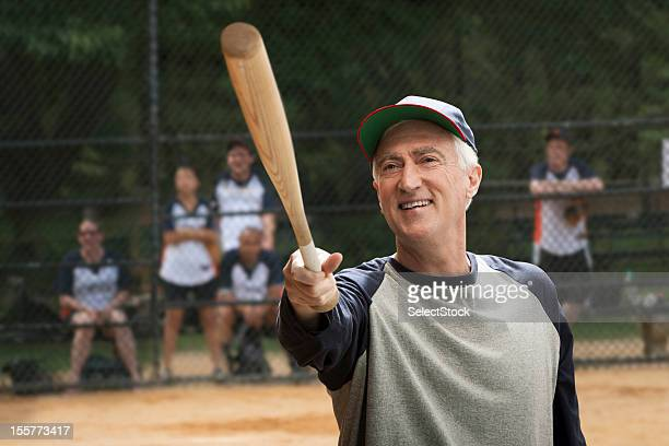 Senior man holding baseball bat
