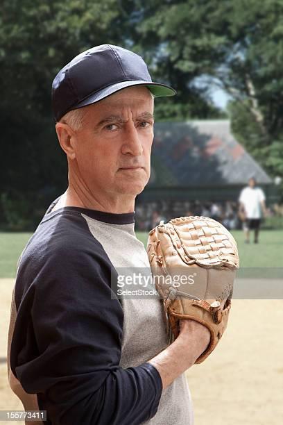 Senior man holding baseball mitt