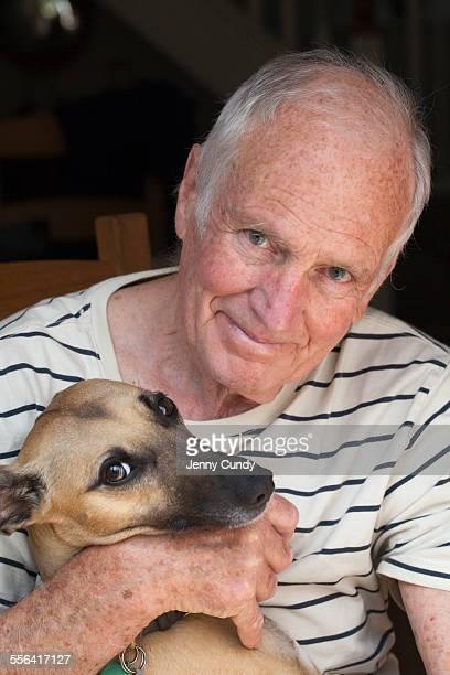 Senior man holding dog