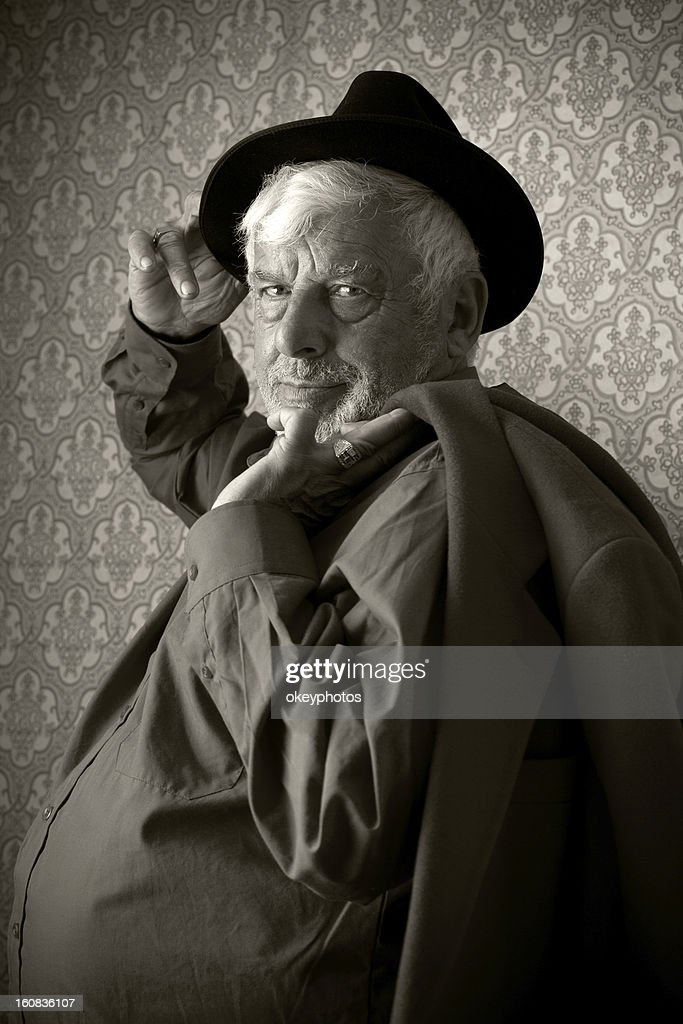 Senior Man Holding His Jacket And Hat, : Stock Photo