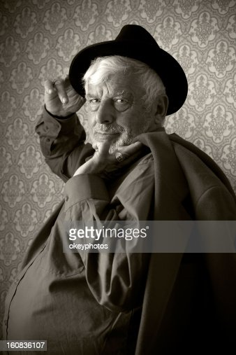 Senior Man Holding His Jacket And Hat, : Bildbanksbilder