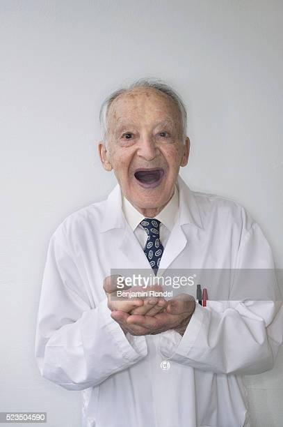 Senior Man Holding His Own Teeth