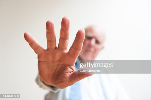 Senior man holding off with his hand