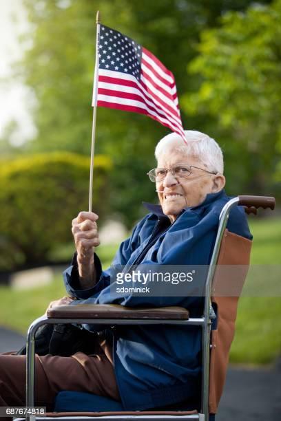 Senior Man Holding US Flag