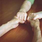 Senior man holds his wife's hands