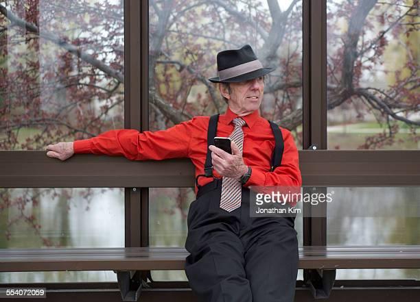 Senior man in bus stop