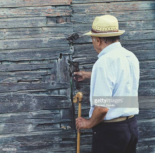 Senior man in front of a traditional door