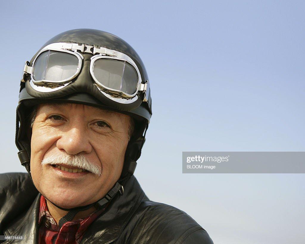 Senior Man In Leather Jacket And Helmet