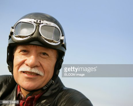 Senior Man In Leather Jacket And Helmet