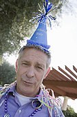Senior man in party hat