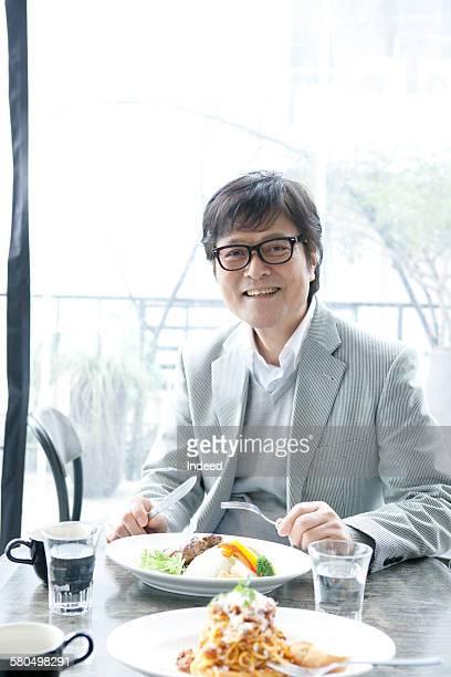 Senior man in restaurant