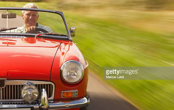 Senior man in sports car