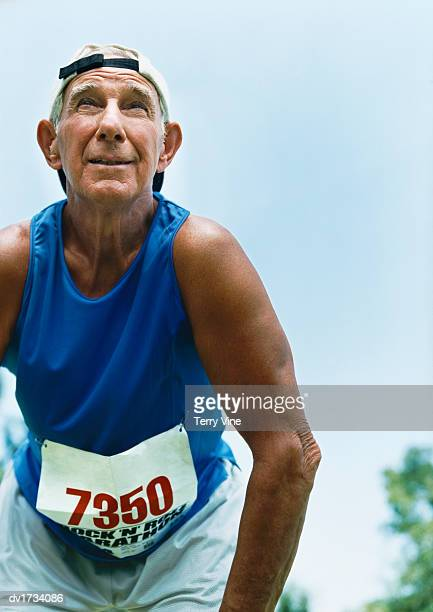 Senior Man in Sportswear in Starting Position