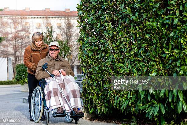 Senior Man in Wheelchair and Daughter in the City, Europe