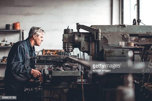 Senior man in workshop