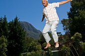 Senior man jumping in midair