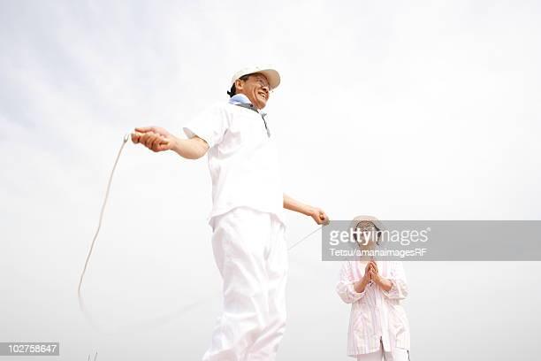 Senior man jumping rope