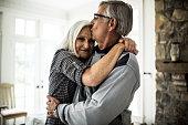 Senior man kissing wife on forehead
