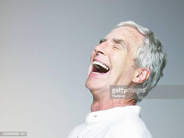 Senior man laughing, close-up