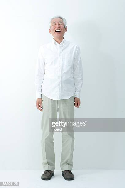 Senior man laughing, full length, portrait
