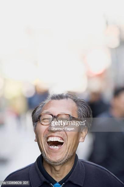 Senior man laughing, mouth open