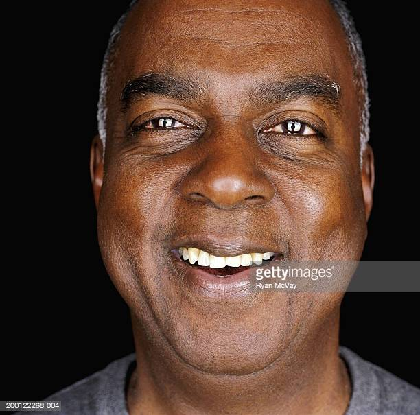 Senior man laughing, portrait, close-up