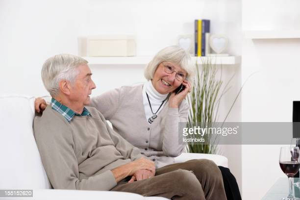 Senior Man Looking Concerned While Wife Puts A Brave Face