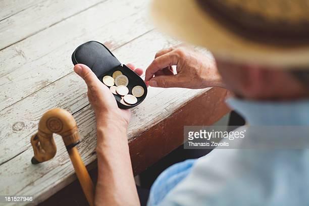 Senior man looking in his wallet