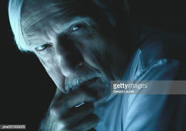 Senior man looking into camera, close-up