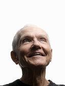 Senior man looking up, smiling