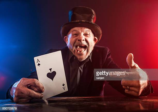 Senior man making trick with playing cards