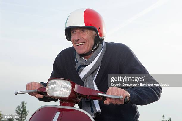 Senior man on scooter