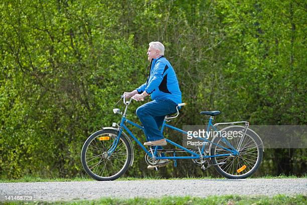 Senior man on tandem bike