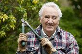 Senior man out gardening