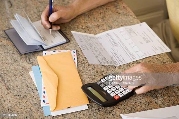 Senior man paying bills