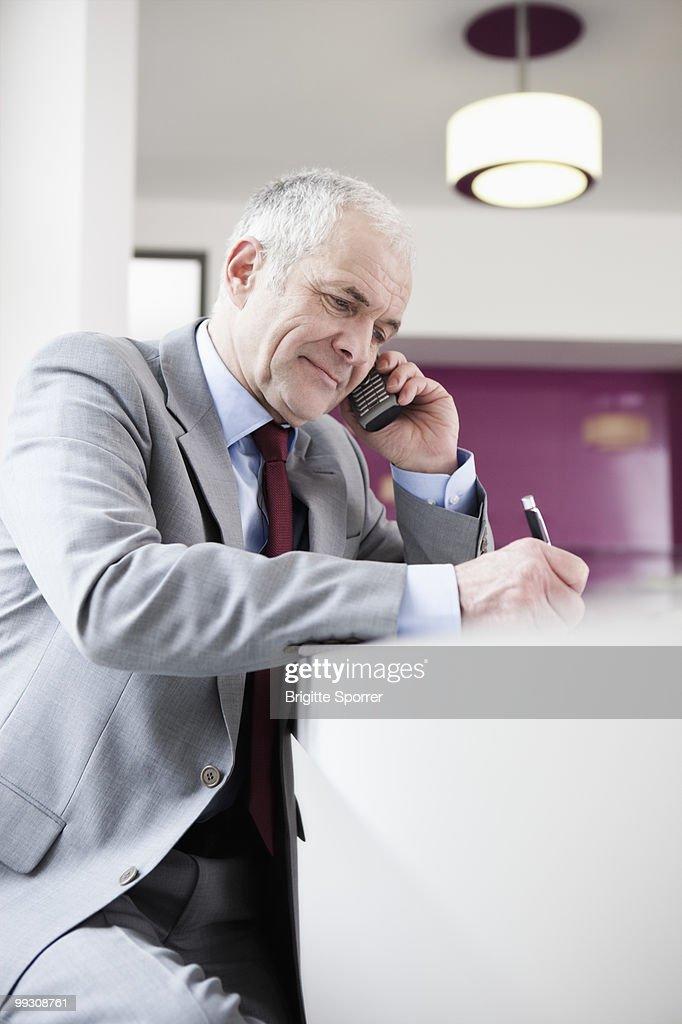 Senior man phoning : Stock Photo