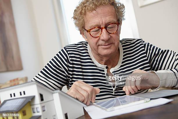 Senior man planning residential building