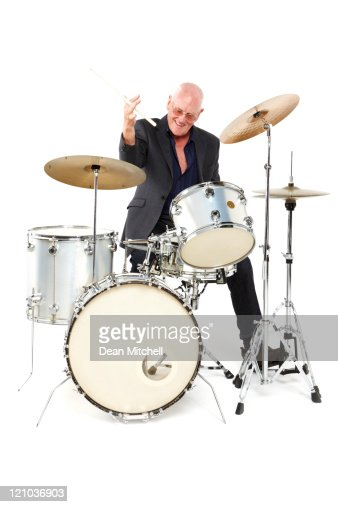 Senior Man Playing a Drum Set - Isolated