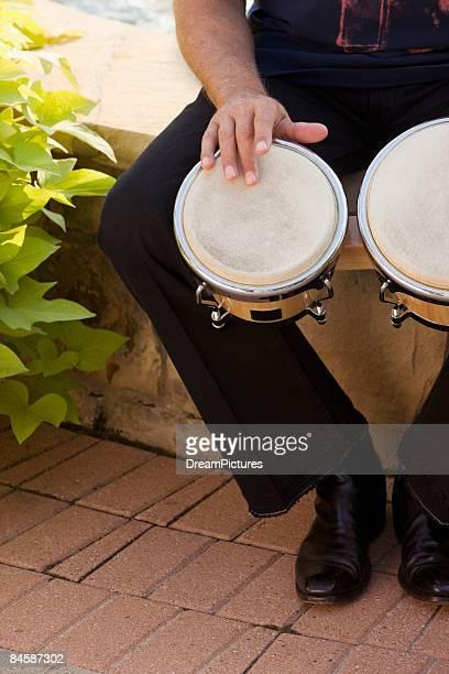 Senior man playing bongos
