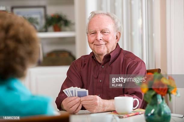 Senior Man playing Cards