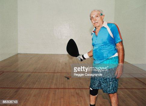 Senior man playing paddleball