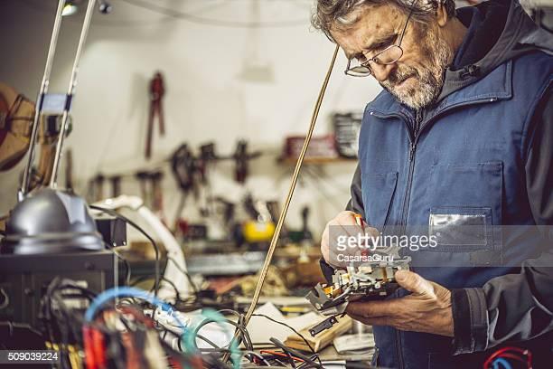 Senior Man Portrait in Mechanical Workshop