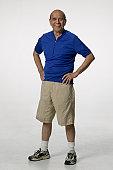 Senior man posing in studio, portrait